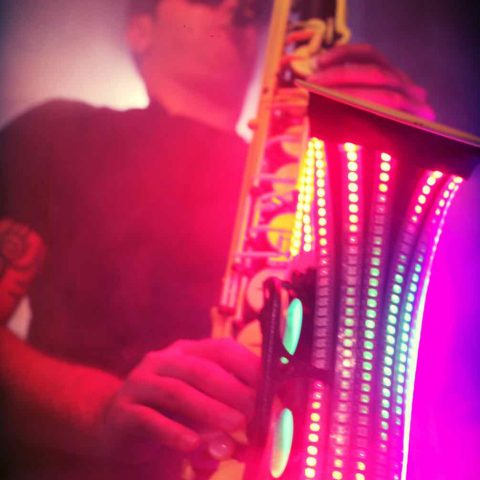 saxophone player with dj led uv